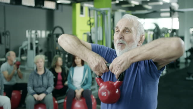 senior man working out with a kettle bell - weights stock videos & royalty-free footage