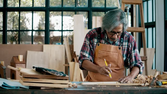 senior man working with wood - artist stock videos & royalty-free footage
