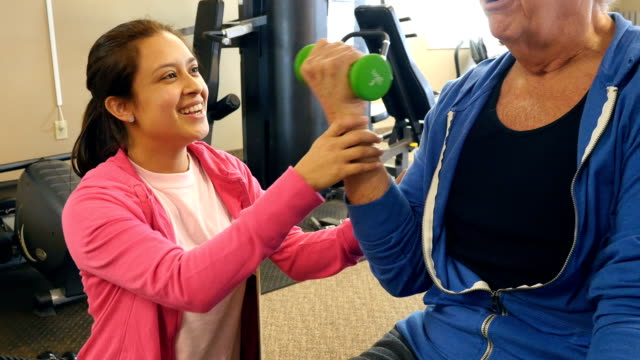 Senior man works out with personal trainer