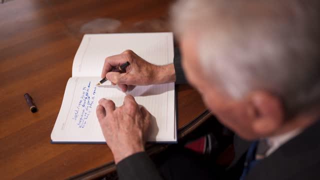 senior man writing a novel - diary stock videos & royalty-free footage