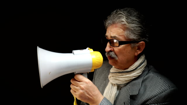 senior man yelling at megaphone - mustache stock videos and b-roll footage