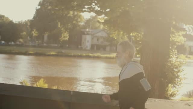 senior marathon runner (slow motion) - leisure activity stock videos & royalty-free footage