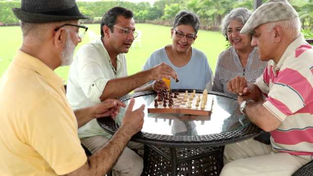 senior men and senior woman playing chess at home, delhi, india - chess stock videos & royalty-free footage