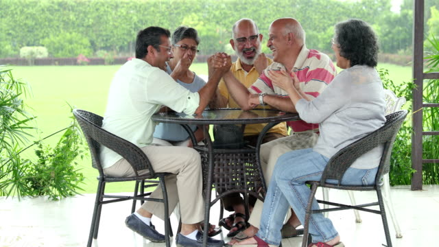 senior men and senior women playing arm wrestling at home, delhi, india - arm wrestling stock videos & royalty-free footage