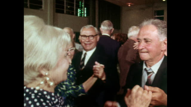vídeos de stock e filmes b-roll de senior men and women dancing together in a ballroom; 1969 - imagem múltipla