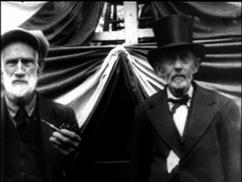 b/w 1927 portrait 2 senior men at elderly convention / newsreel - 1927年点の映像素材/bロール