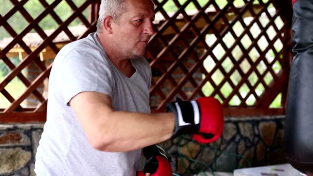 Senior men Boxing training outdoors