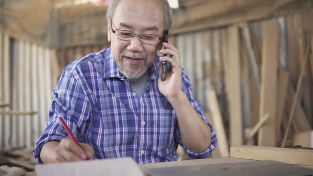 senior men calling to order. - manual worker stock videos & royalty-free footage