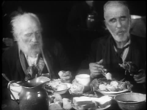 b/w 1929 2 senior men eating ravenously in soup kitchen / great depression / newsreel - 1920 1929 stock videos & royalty-free footage
