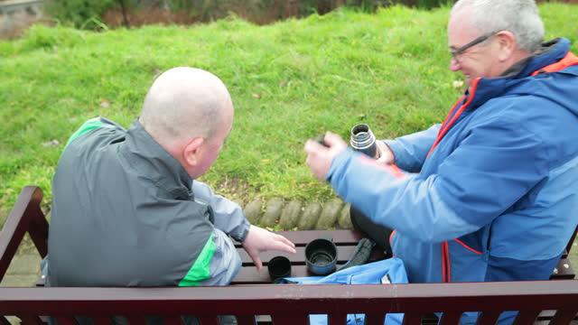 senior men enjoying coffee - hot drink stock videos & royalty-free footage
