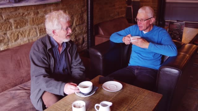 senior men enjoying morning coffee in bar - modern manhood stock videos & royalty-free footage