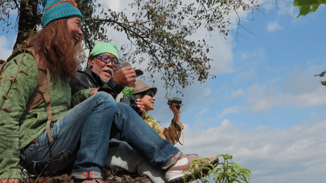 vidéos et rushes de senior men enjoying view with there wife from top during hike in mountains at morning - activité de plein air