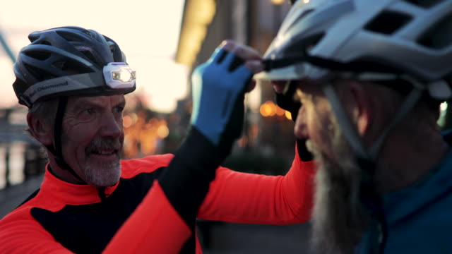 senior men fixing flashlight on helmet - cycling helmet stock videos & royalty-free footage