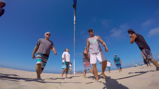 pov of senior men playing beach volleyball. - slow motion - wearable camera stock videos & royalty-free footage