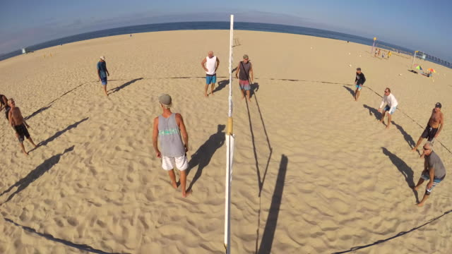 pov of senior men playing beach volleyball. - time-lapse - volleyball sport stock videos and b-roll footage