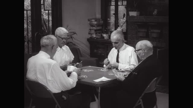 MS Senior men playing cards in senior center / United States