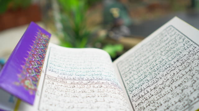 senior men reading holy quran - religion stock videos & royalty-free footage