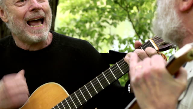 senior men sing, play guitar, and laugh - musical instrument stock videos & royalty-free footage