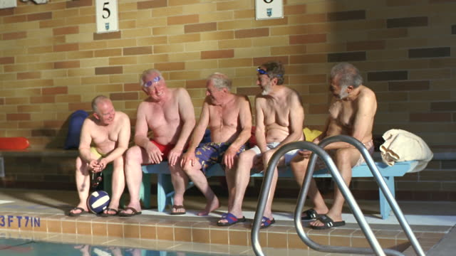 ws senior men sitting side by side on poolside bench / seattle, washington, usa - side by side stock videos & royalty-free footage
