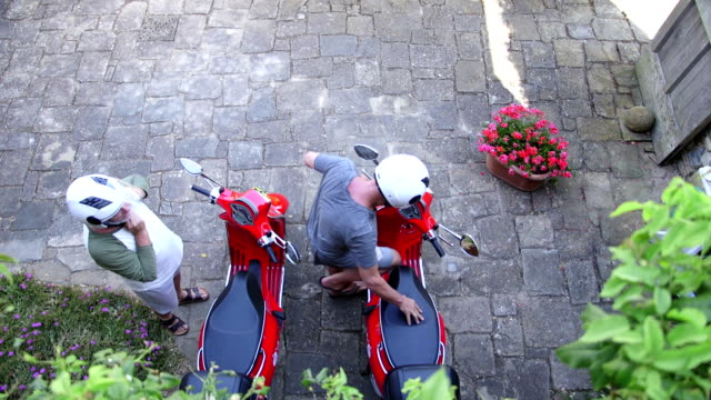 senior men taking their mopeds for a spin - moped stock videos and b-roll footage