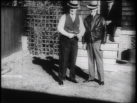 b/w 1936 2 senior men tossing horseshoes / documentary - horseshoe stock videos and b-roll footage