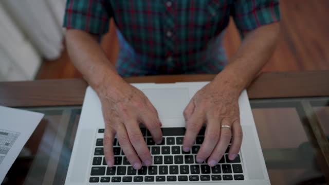 senior men using laptop - retirement community stock videos & royalty-free footage