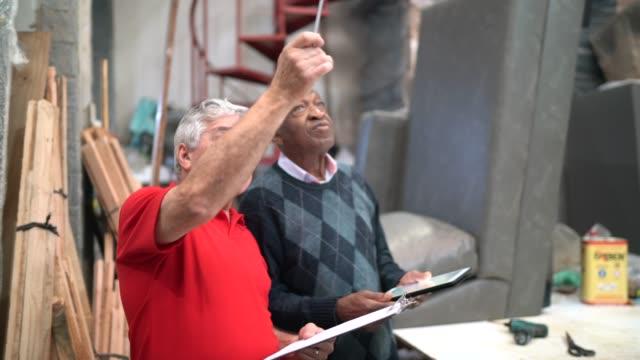 senior men working in an upholstery workshop - pardo brazilian stock videos & royalty-free footage