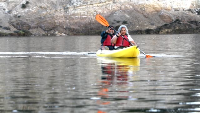 senior mexican couple kayaking - overweight active stock videos & royalty-free footage