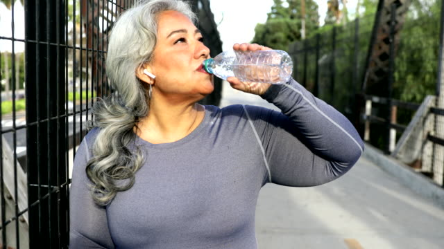 senior mexican woman drinking water - drinking water stock videos & royalty-free footage