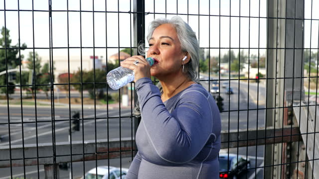 senior mexican woman drinking water - drinking stock videos & royalty-free footage