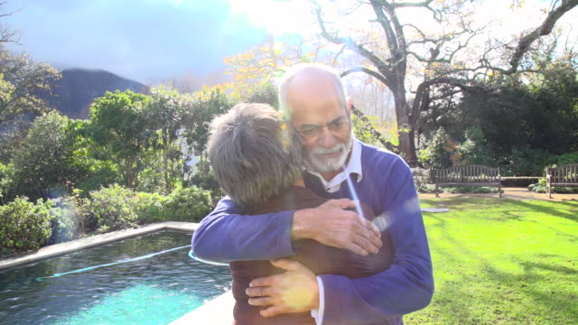 MLS senior mixed race  couple embracing in garden/ Cape Town/ South Africa
