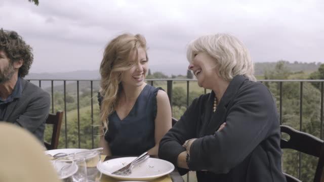 vídeos de stock e filmes b-roll de senior mother with daughter at family meal - filha