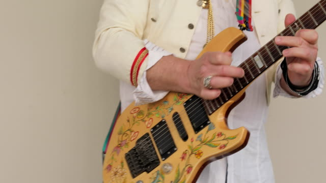 senior musician playing electric guitar outdoors - customized stock videos and b-roll footage