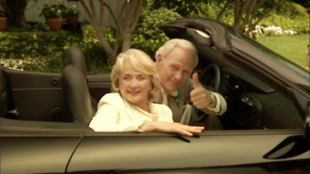 cu, senior newly wed couple in convertible car, portrait - jung geblieben stock-videos und b-roll-filmmaterial