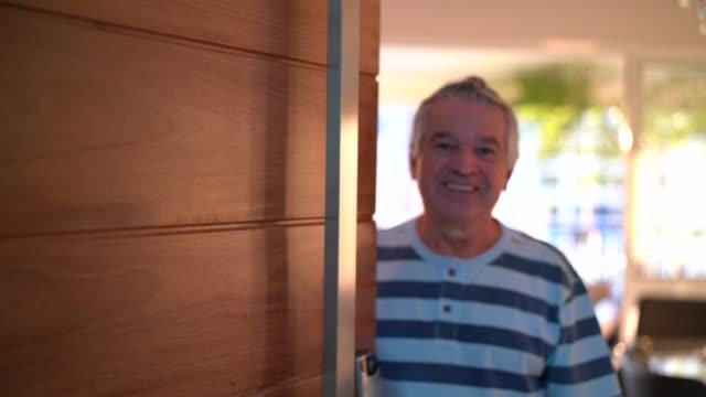 senior opening his front door - front door stock videos & royalty-free footage
