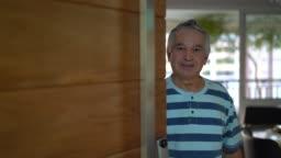 Senior Opening His Front Door