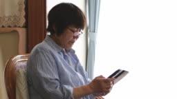 Senior operating a smartphone.
