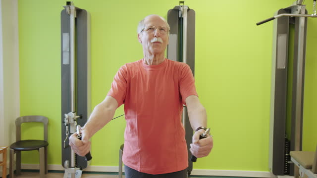senior patient exercising with pulley at hospital - three quarter length stock videos & royalty-free footage
