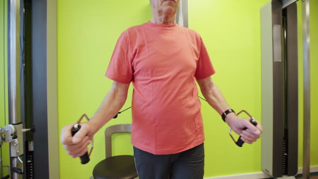 senior patient exercising with pulley at hospital - rehabilitation center stock videos & royalty-free footage