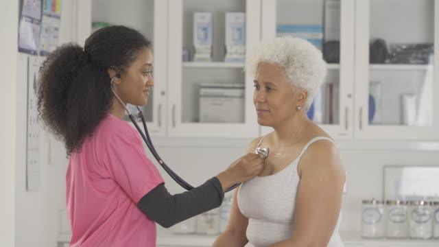 senior patient in doctor's office - stethoscope stock videos & royalty-free footage