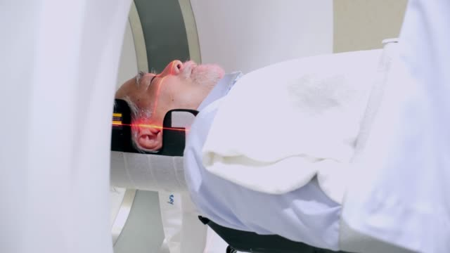 senior patient is scanned by mri, ct scanner. magnetic resonance examination. - mri scanner stock videos and b-roll footage