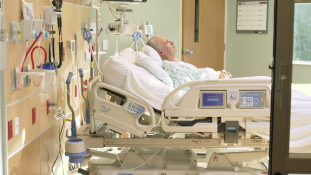 Senior patient recovering in hospital ICU