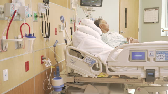 Senior patient recovering in hospital ICU