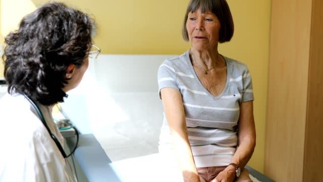 senior patient talking to doctor at office - illness stock videos & royalty-free footage