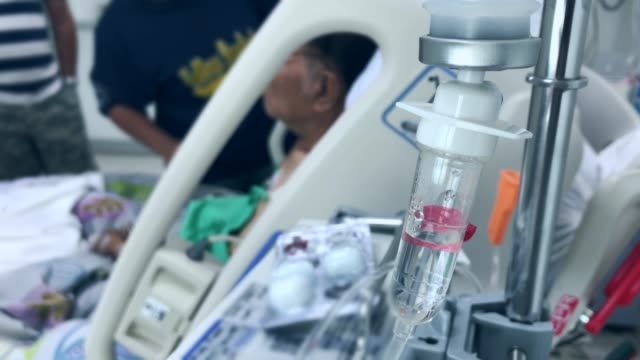 senior patient was given saline on the bed in hospital - saline stock videos and b-roll footage