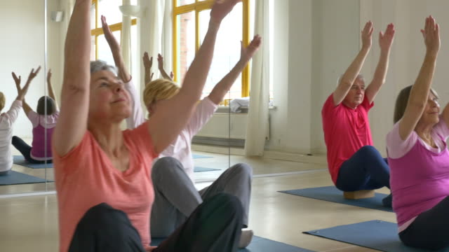 senior people doing yoga in health club - yoga studio stock videos & royalty-free footage