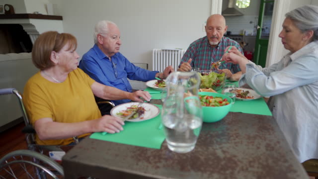 senior people having lunch in nursing home - retirement community stock videos & royalty-free footage