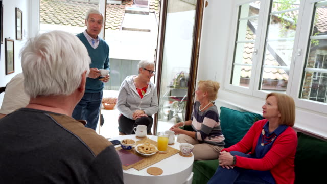 senior people on pension gathering together at tea party and having amazing time - retirement community stock videos & royalty-free footage