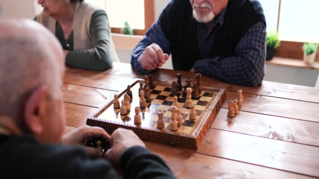 senior people playing chess in elderly resident - board game stock videos & royalty-free footage