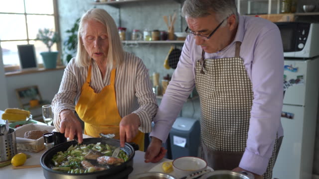 senior people preparing healthy food at kitchen - wife stock videos & royalty-free footage